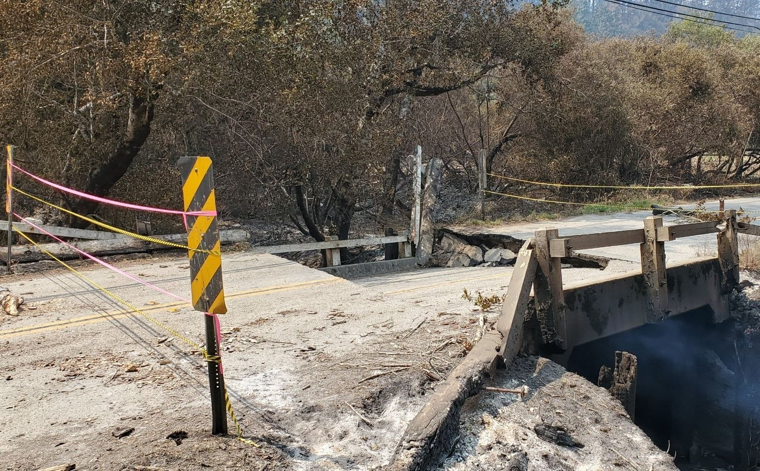 A road is closed after damage during the CZU Lightning Complex Fire in 2020. (Cal Fire)